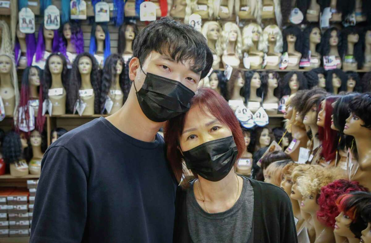 Sungjun Lee holds his mother Jung Kim, who own Uptown Beauty Supply, 12412 Kuykendahl Rd. They were victims as customers assaulted the family on March 17 at the store in an unprovoked attack Wednesday, March 24, 2021, in Houston.