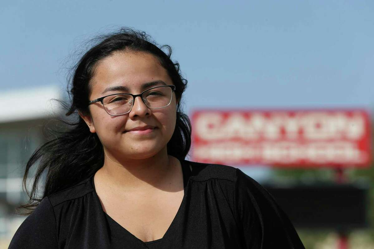 Brittany Soto, 19, poses in front of Canyon High School in New Braunfels, where she graduated last May. She is a school board candidate in Comal ISD for the District 1 seat.