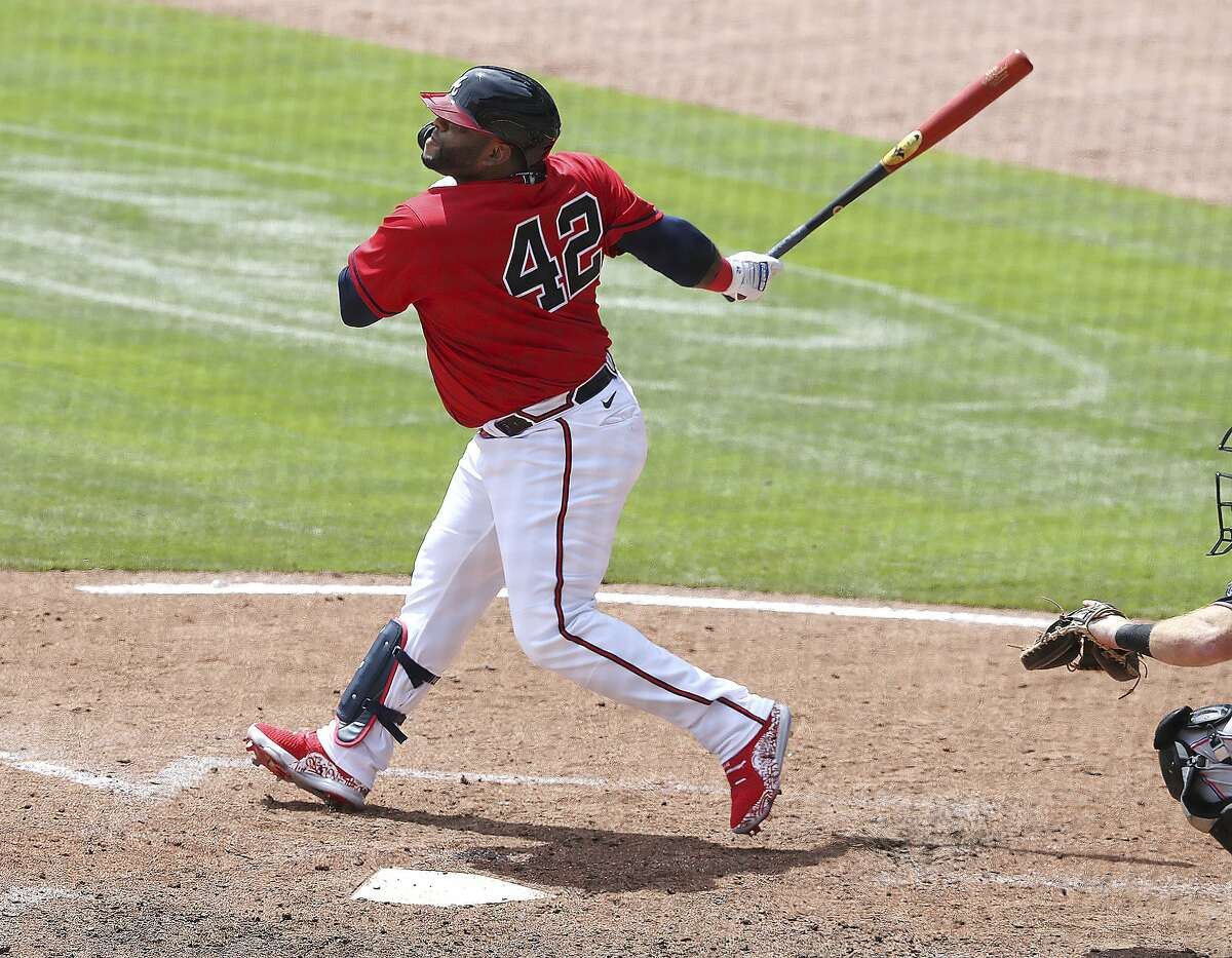 Atlanta Braves pinch hitter Pablo Sandoval hits a three-RBI home run against the Miami Marlins during the sixth inning of a baseball game Thursday, April 15, 2021, in Atlanta. (Curtis Compton/Atlanta Journal-Constitution via AP)
