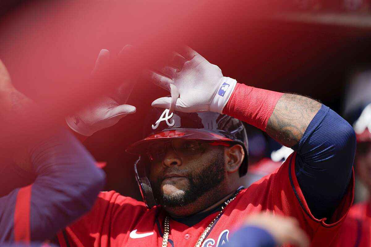 Atlanta Braves' Pablo Sandoval (48) celebrates after scoring a home run in the sixth inning of a baseball game against the Miami Marlins Thursday, April 15, 2021, in Atlanta. (AP Photo/Brynn Anderson)