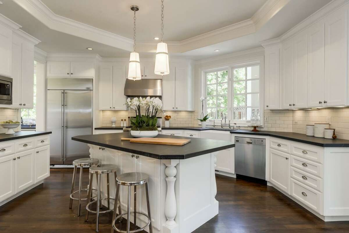 The remodeled kitchen with island also includes a butler's pantry.
