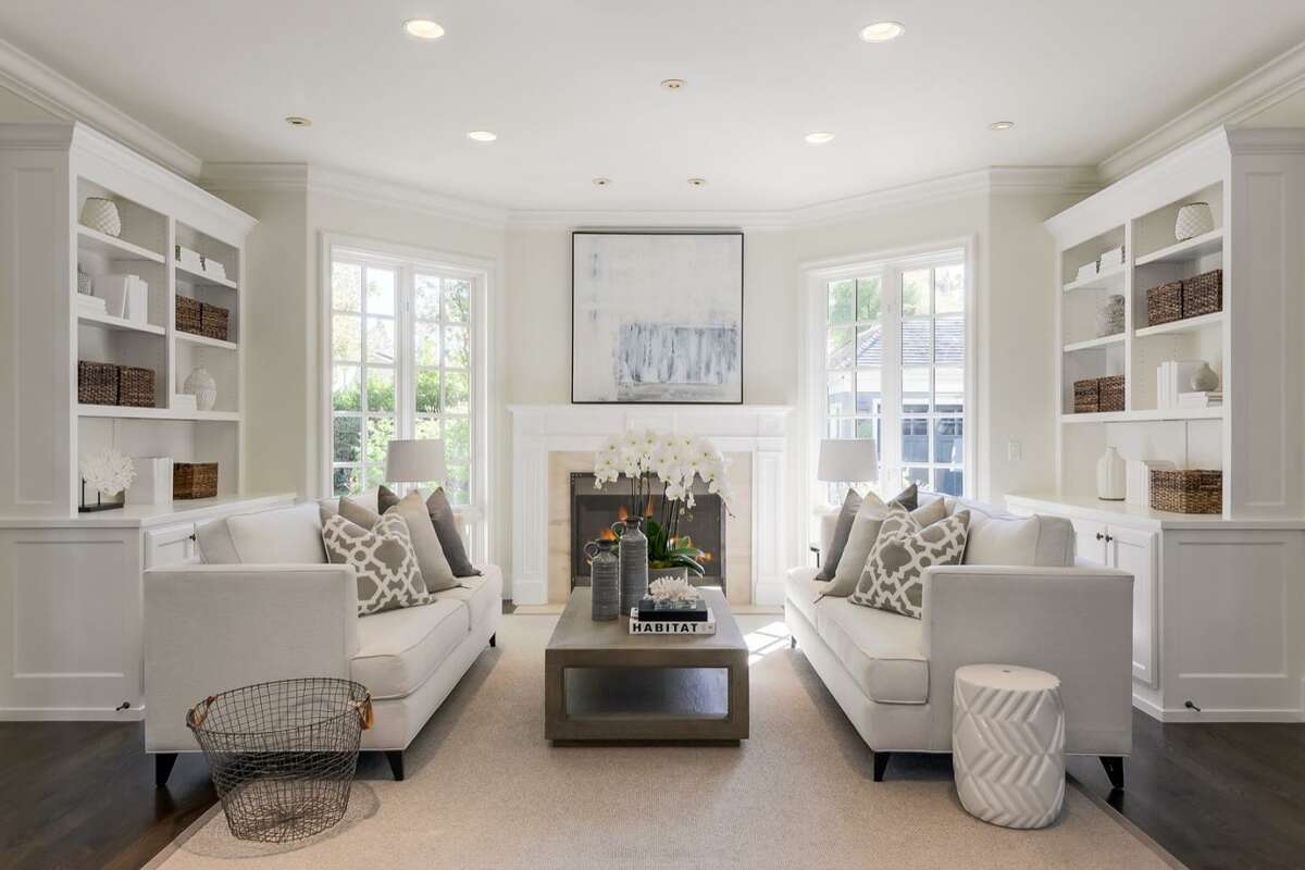 The family room includes built-in bookshelves and one of two fireplaces in the house.