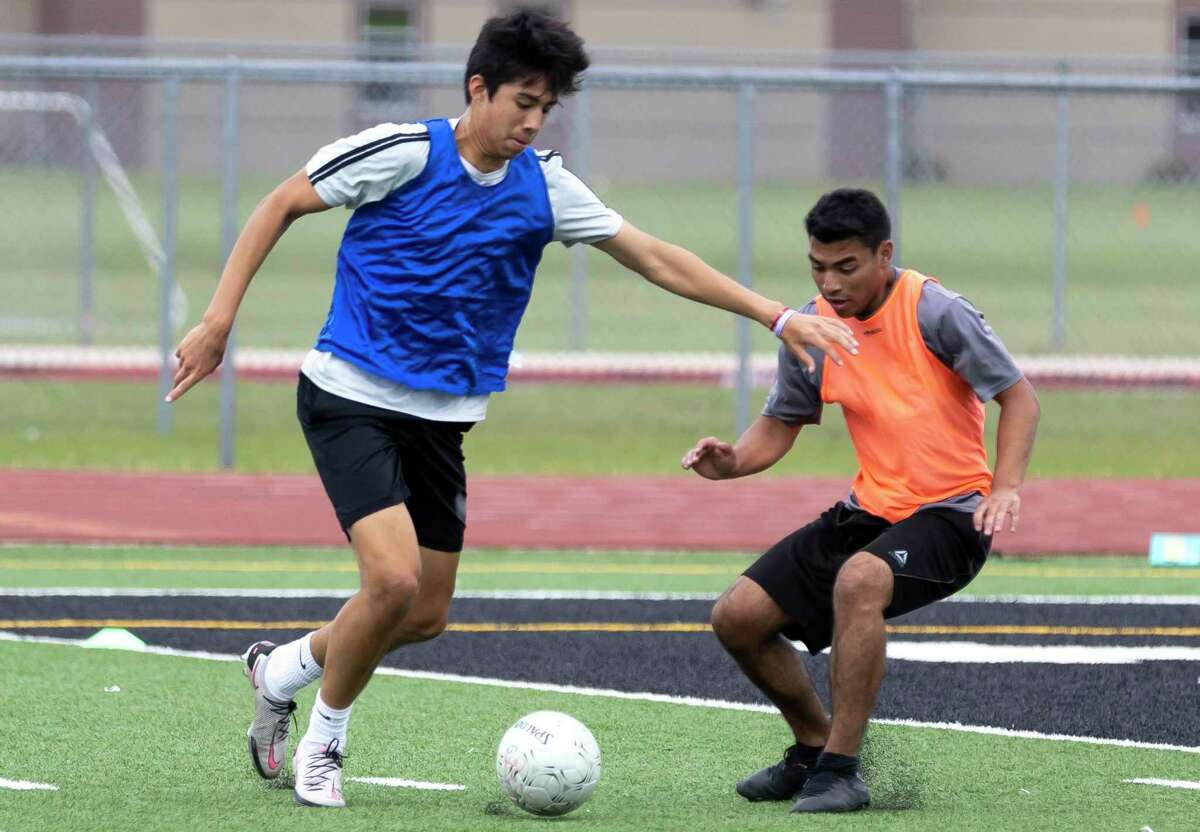 Jesus Cervantes of Kingwood Park, senior, left, drives the ball while under pressure during practice at Panthers Stadium in Kingwood Park High School, Thursday, April 15, 2021, in Kingwood. Kingwood Park will faceoff Wakeland High School, Saturday, April 17, during the 2021 Boys Soccer State Championship - UIL 5A Boys Soccer Championship in Georgetown.
