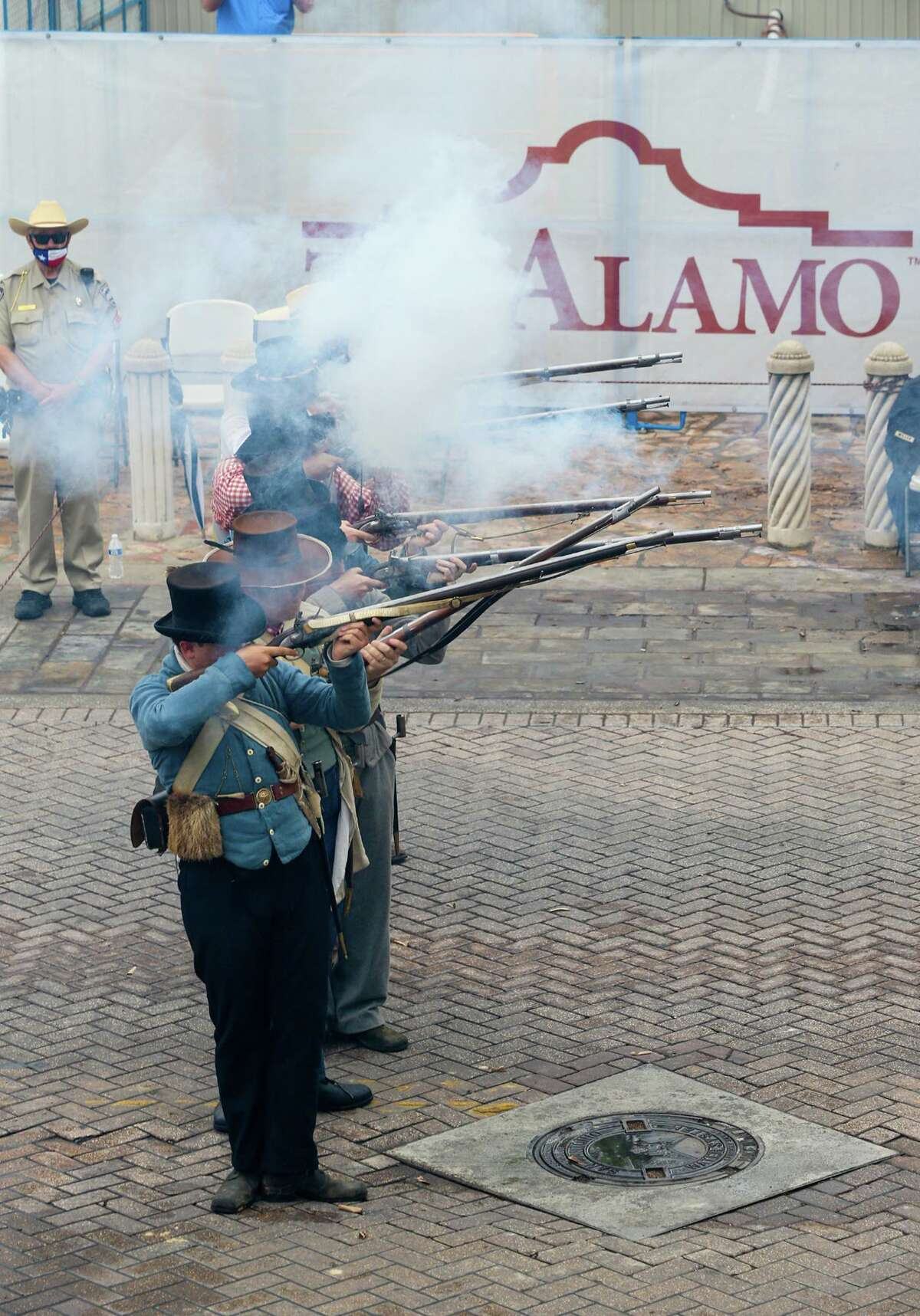 Living historians fire a musket volley as state and local officials gathered for the unveiling of a new outdoor