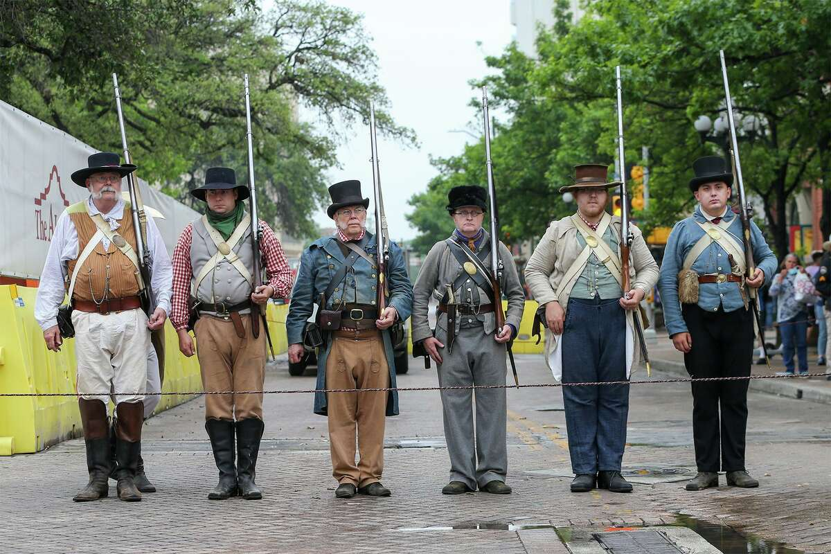 Living historians stand at attention as state and local officials gathered for the unveiling of a new outdoor