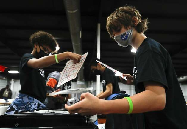 Lanndon Dreahn helps unpack during the ag robotics competition at the Montgomery County Fair & Rodeo, Friday, April 16, 2021, in Conroe. This competition offered students from Montgomery County with an interest in STEM related fields the opportunity to competed against their peers in an agricultural focused course designed to challenge students to use their robot to complete various tasks for points. Photo: Jason Fochtman/Staff Photographer / 2021 © Houston Chronicle