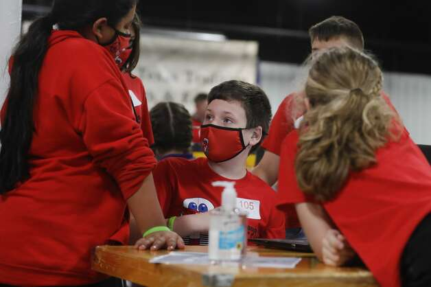 SplendoraÕs Klinton Cool reads instructions to teammates during the ag robotics competition at the Montgomery County Fair & Rodeo, Friday, April 16, 2021, in Conroe. This competition offered students from Montgomery County with an interest in STEM related fields the opportunity to competed against their peers in an agricultural focused course designed to challenge students to use their robot to complete various tasks for points. Photo: Jason Fochtman/Staff Photographer / 2021 ? Houston Chronicle