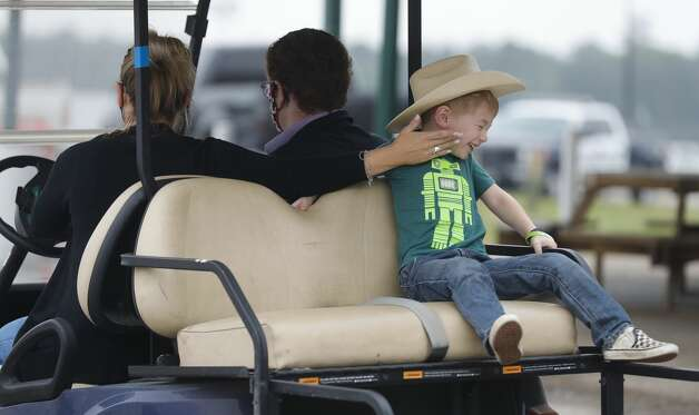 Waylon Holcombe, right, laughs as his mother, Amber, plays with him before the start of the ag robotics competition at the Montgomery County Fair & Rodeo, Friday, April 16, 2021, in Conroe. This competition offered students from Montgomery County with an interest in STEM related fields the opportunity to competed against their peers in an agricultural focused course designed to challenge students to use their robot to complete various tasks for points. Photo: Jason Fochtman/Staff Photographer / 2021 ? Houston Chronicle
