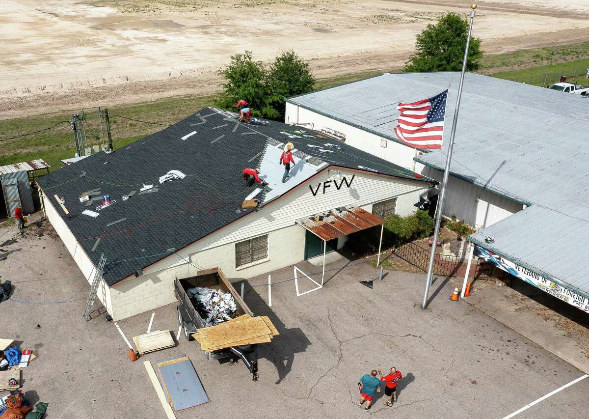 About a dozen or more roofers tackled the massive job at the VFW Post 8905 in Cypress that took about two days to complete. The building being worked on is the original VFW Post and crews will tackle the metal building in the back next.