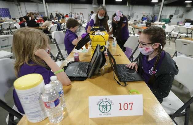 CC Hardy Elementary students Sarah Adams, right, and Laird Walters go through programing software during the ag robotics competition at the Montgomery County Fair & Rodeo, Friday, April 16, 2021, in Conroe. This competition offered students from Montgomery County with an interest in STEM related fields the opportunity to competed against their peers in an agricultural focused course designed to challenge students to use their robot to complete various tasks for points. Photo: Jason Fochtman/Staff Photographer / 2021 ? Houston Chronicle