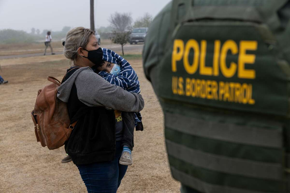 LA JOYA, TEXAS - APRIL 10: Central American immigrants wait to be processed by U.S. Border Patrol agents alongside a road near the border with Mexico on April 10, 2021 in La Joya, Texas. A surge of immigrants crossing the southern border, including record numbers of children, continues. (Photo by John Moore/Getty Images)