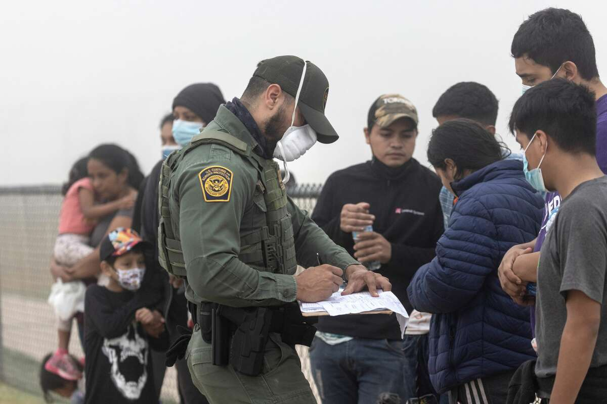 LA JOYA, TEXAS - APRIL 10: A U.S. Border Patrol agent takes the names of Central American immigrants near the U.S.-Mexico border on April 10, 2021 in La Joya, Texas. A surge of immigrants crossing into the United States, including record numbers of children, continues along the southern border. (Photo by John Moore/Getty Images)