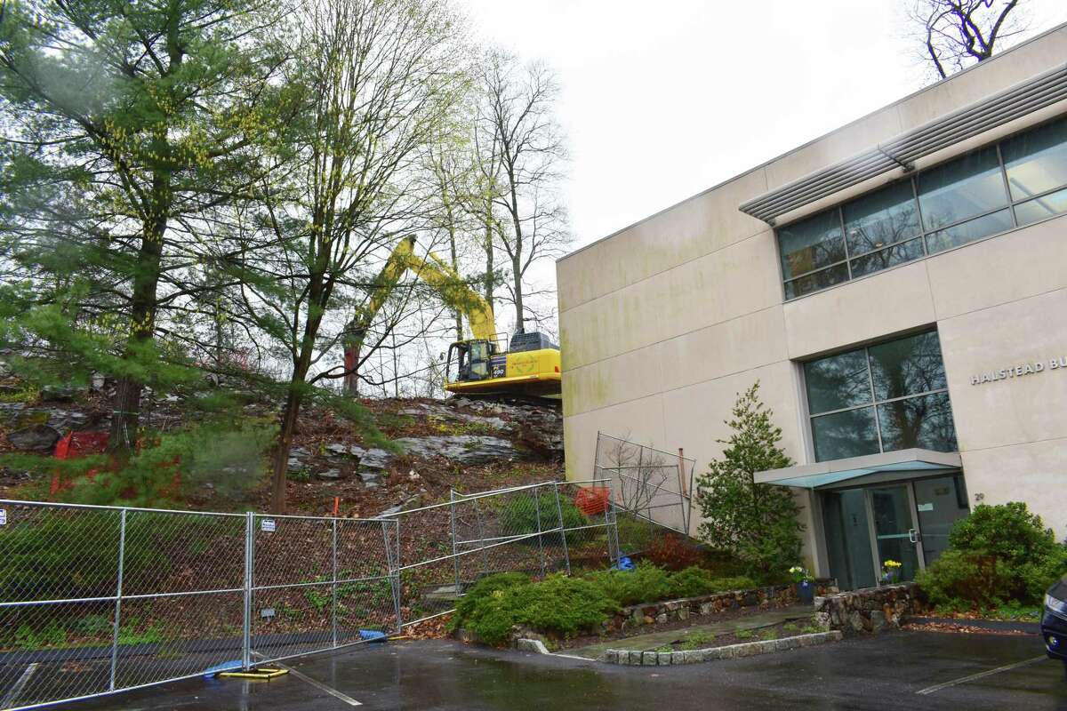 Construction preparations continue in a drizzle on Thursday, April 15, 2021, for HTMX Industries planned design center that will seek certification from the Living Building Challenge for environmental sustainability.