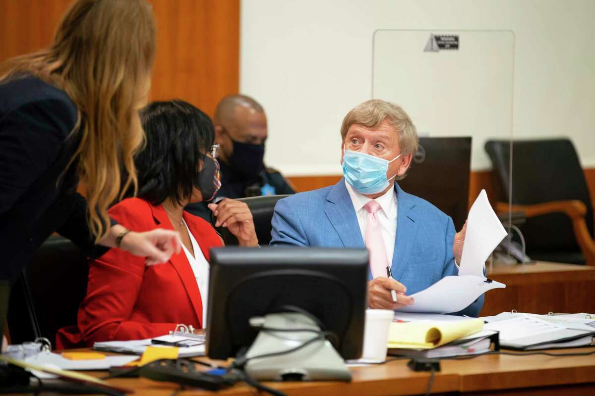 Attorney Rusty Hardin, who is representing Texans quarterback Deshaun Watson, confers with his team during a hearing before State Civil District Judge Rabeea Sultan Collier's court on Friday, April 9, 2021, at the Harris County Civil Courthouse in Houston. Hardin is asking the judge to make the names of his client Deshaun Watson's clients no longer anonymous on the civil lawsuits that have been filed against him. The attorney representing the women, Tony Buzbee, appeared at the hearing virtually.