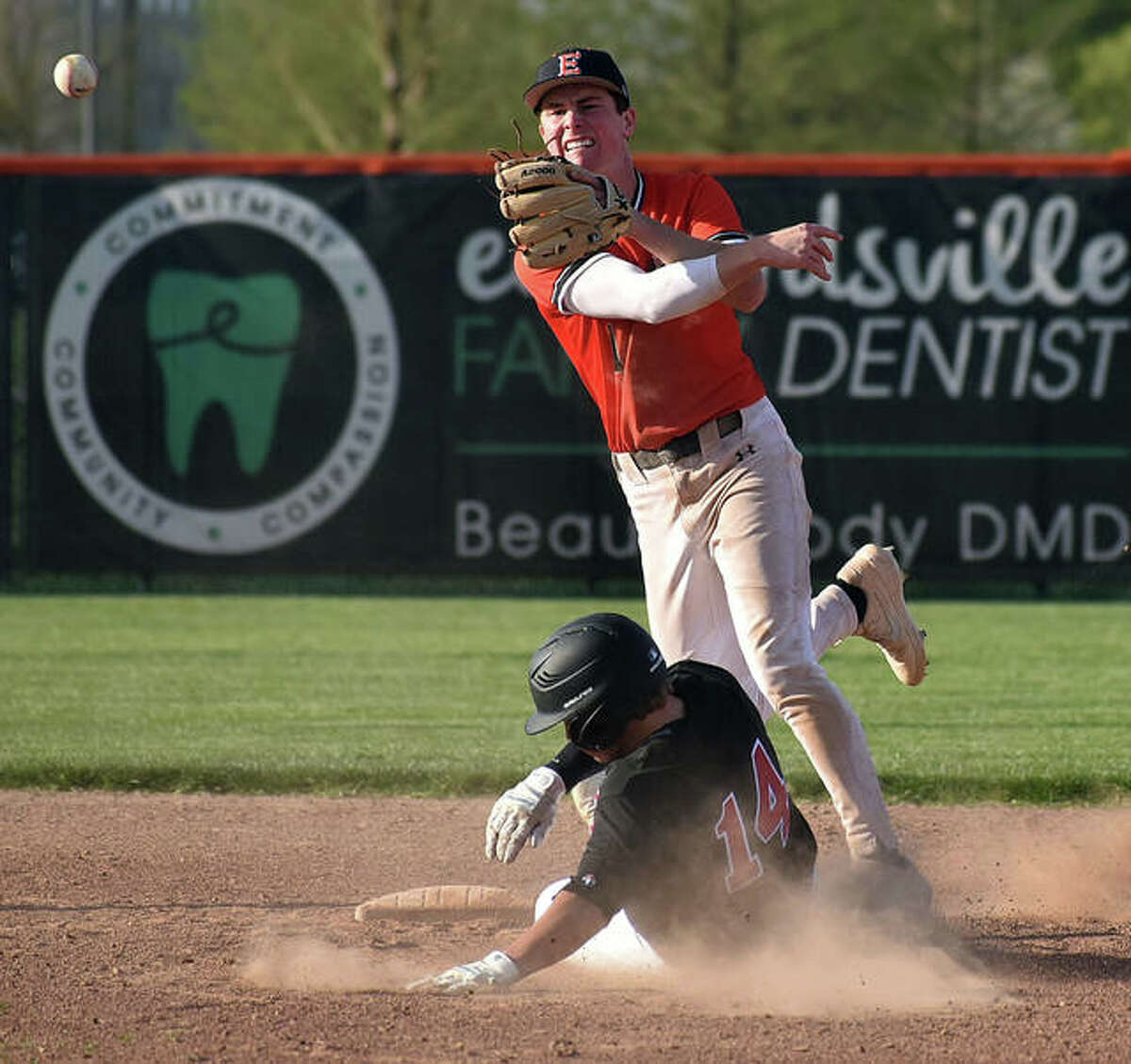 Edwardsville second baseman Evan Funkhouser fires a throw to first base to try and complete a double play against Highland in the fourth inning.