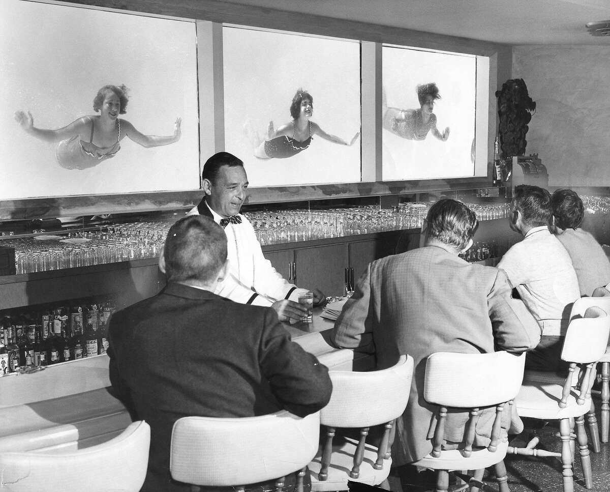A bartender serves patrons in 1956 at Millbrae's El Rancho Hotel, adjacent to a swimming pool. A builder wants to redevelop the historic 6.7-acre property.