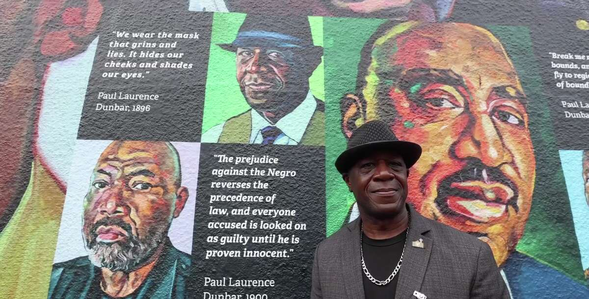 The mural shows off 30 portraits, all packed into a 100-foot wide space.