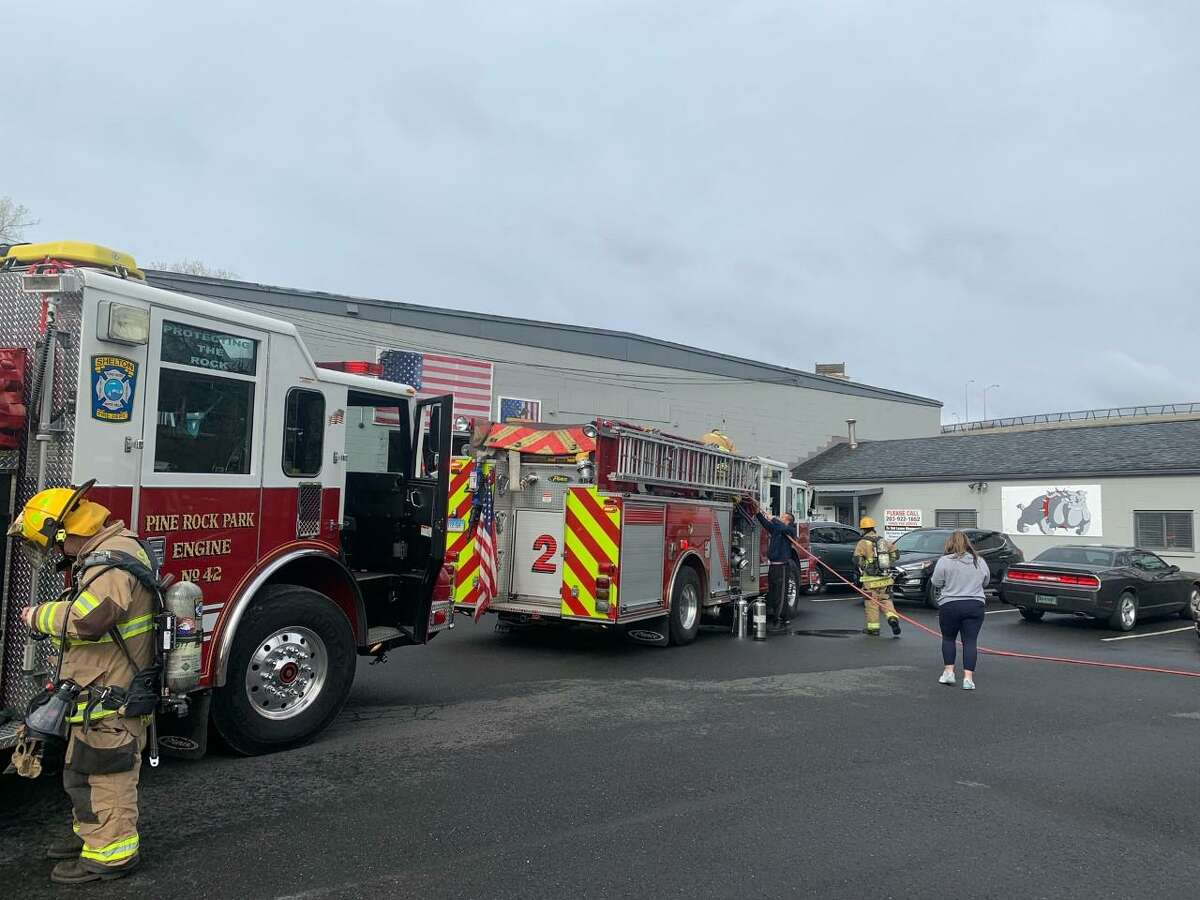 Shelton firefighters battled a small fire at Charter Arms, 18 Brewster Lane, on Friday, April 16, 2021.