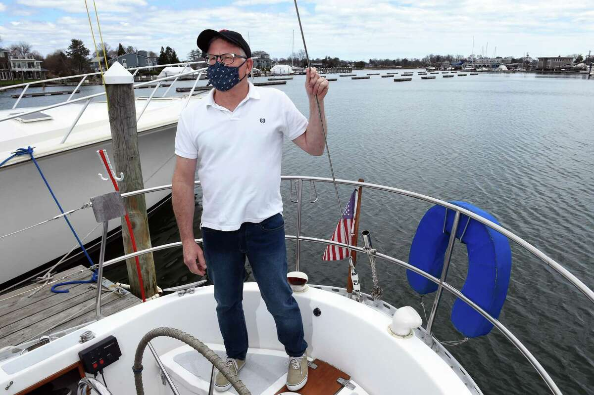 Chris Tack pon board the Sequester at Milford Point Marina on April 13, 2021. His business, Captain Tack's Long Island Sound Sail and Dine, takes people out on two-hour cruises on the Sound followed by a gourmet dinner.