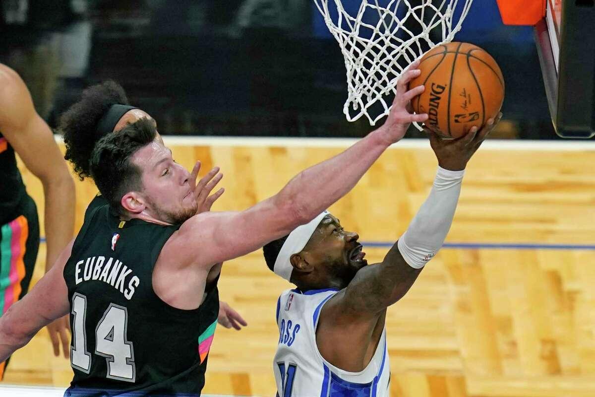 San Antonio Spurs forward Drew Eubanks (14) blocks a shot by Orlando Magic guard Terrence Ross, right, during the first half of an NBA basketball game, Monday, April 12, 2021, in Orlando, Fla. (AP Photo/John Raoux)
