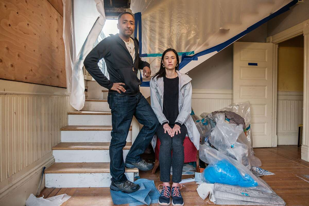 Nicolas King and Dawn Ogawa inside their home on Eureka Street, which was severely damaged by fire.