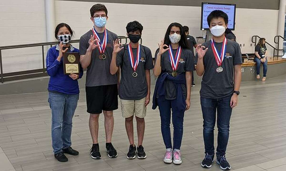 Cypress Woods High School won the District 16-6A UIL Academic Meet, held March 24-25 at Cypress Park High School. The Wildcats' Mathematics team was one of many teams to win a district championship. Pictured, from left, are Tuong-Trang Chang, Cypress Woods UIL math coach; and students Zeki Gurbuz, Ashay Swadi, Ramya Iyer and Alex Huang.