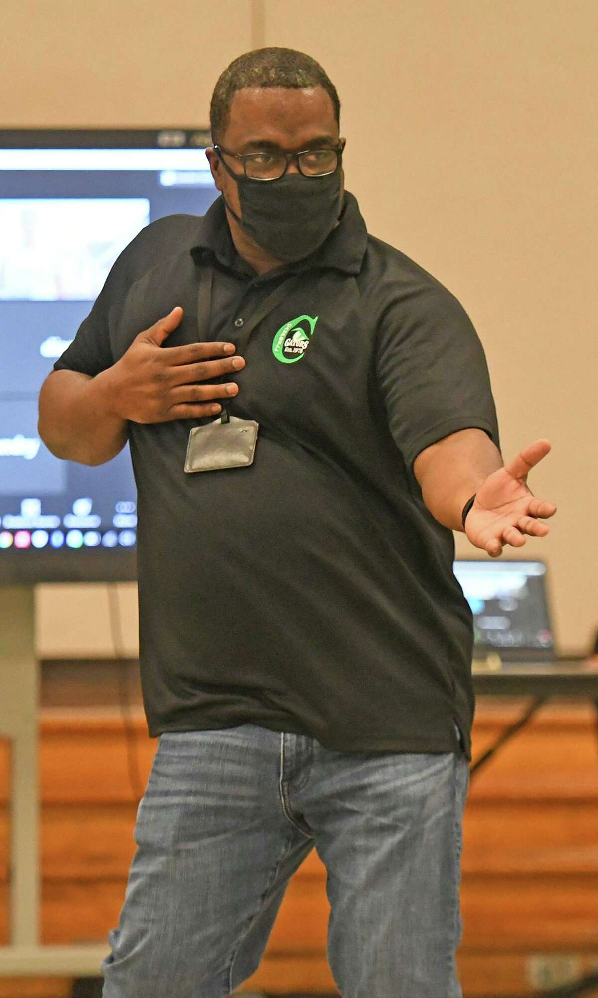 """Campbell Middle School Principal Rashad Godbolt dances during """"Dancing with the Counselors."""""""
