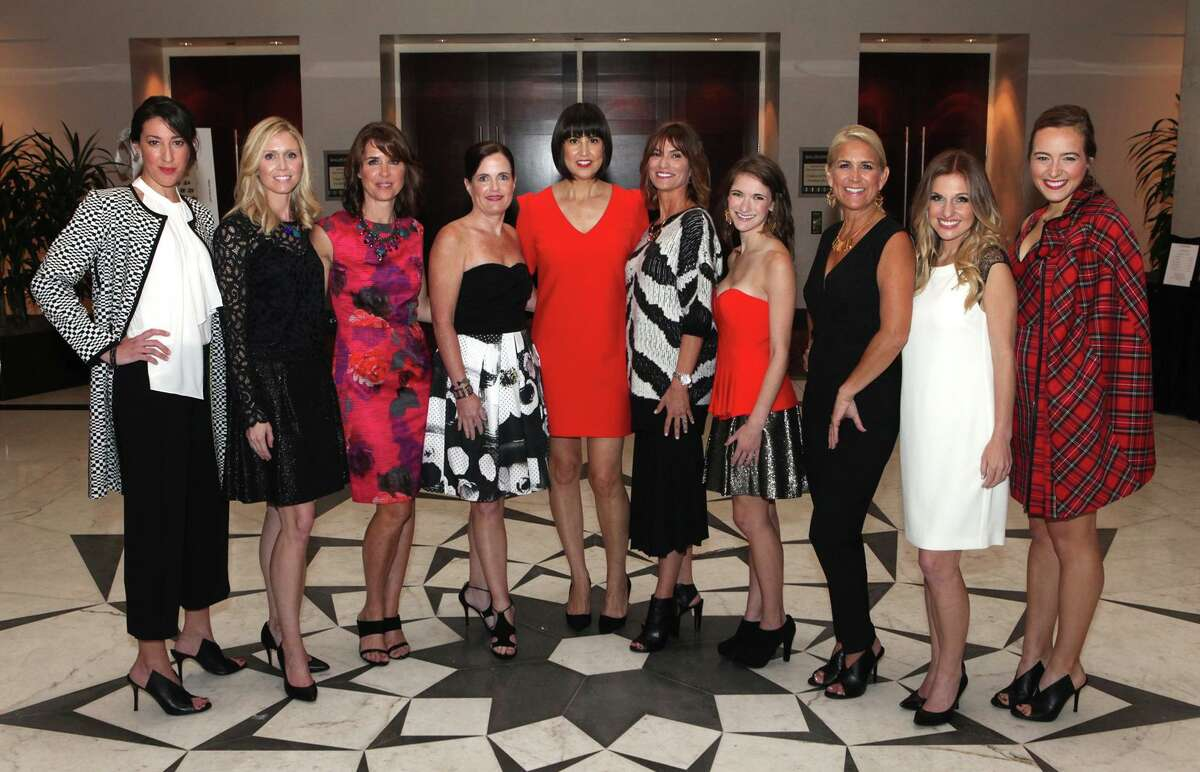 """Models pose with Trina Turk (center) during the """"A Legacy of Style"""" fashion show for Spring Branch Education Foundation at the Hilton Post Oak in Houston, Texas on Friday, November 21, 2014."""