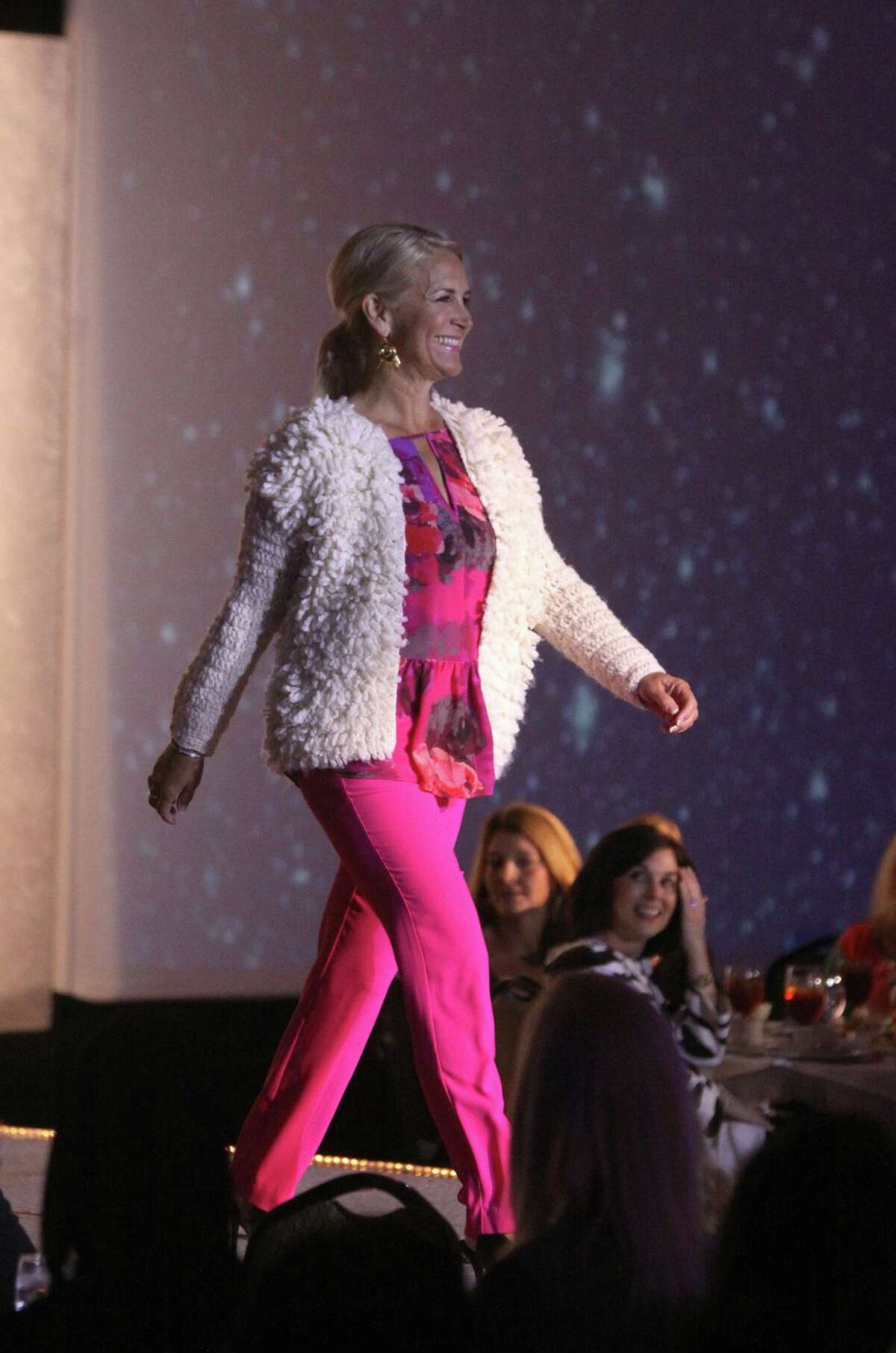 """Model walks down the runway as she models clothes from Trina Turk during the """"A Legacy of Style"""" fashion show for Spring Branch Education Foundation at the Hilton Post Oak in Houston, Texas on Friday, November 21, 2014."""