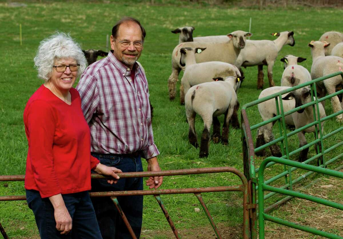 Peter and Carol Sepe pose at Sepe Farm in Newtown, Conn., on Wednesday April 14, 2021. Peter is president of the Fairfield County Farm Bureau, and is one of the few farmers in the state who did benefit from the USDA pandemic relief program.