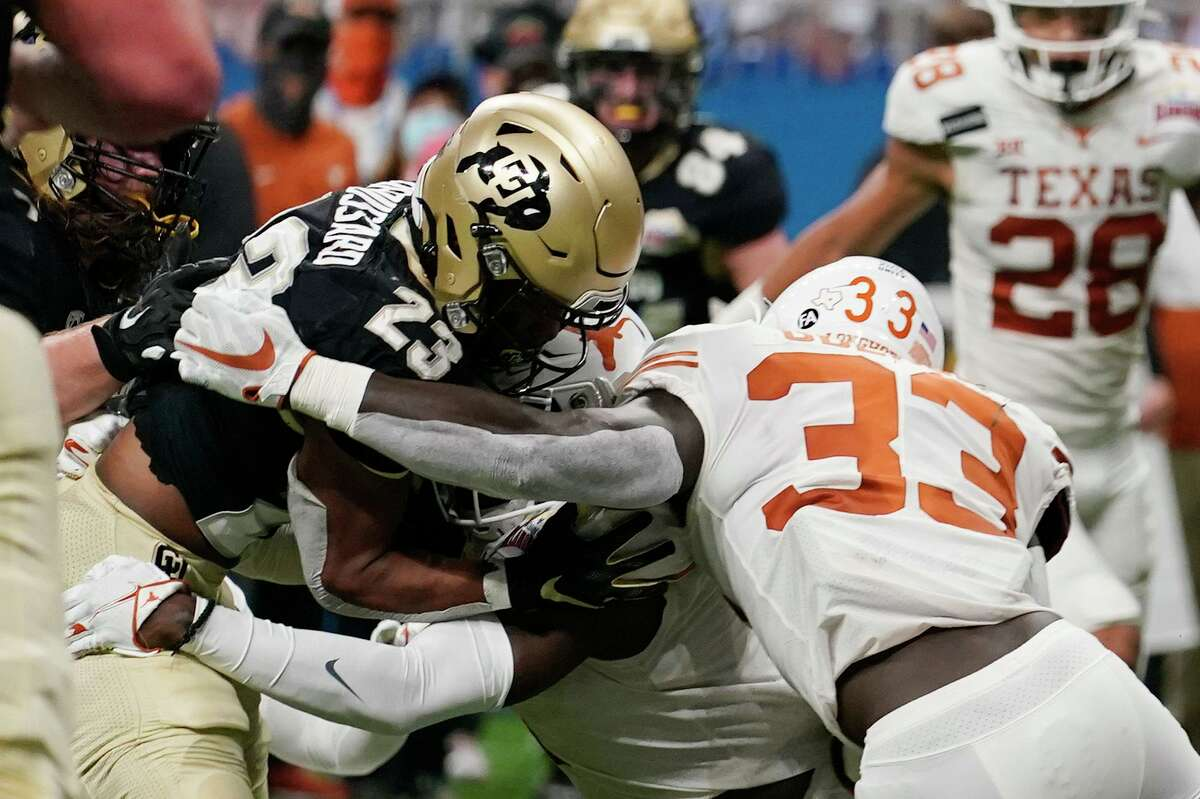 Texas linebacker David Gbenda, tackling Colorado's Jarek Broussard, showed flashes of what he can do in the Alamo Bowl.