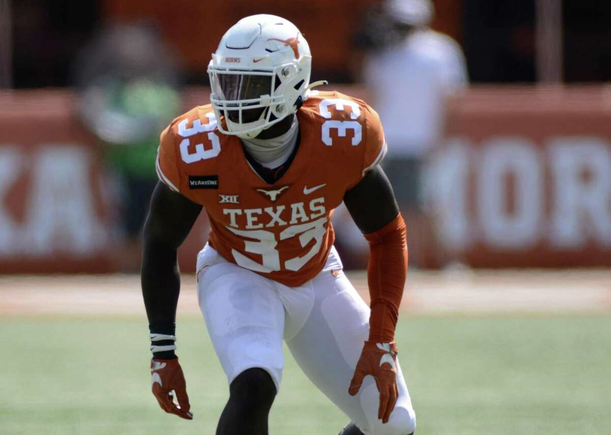 With a game-high seven tackles, linebacker David Gbenda caught the attention of coach Steve Sarkisian during Texas' Orange-White contest Saturday.