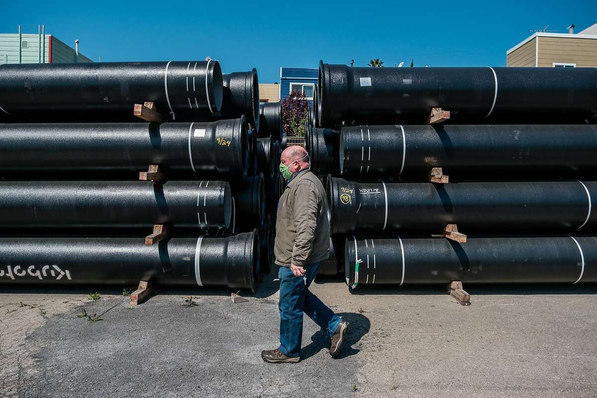 Maintenance Manager Tony Preston walks past the S.F. Public Utilities Commission's stockpile of earthquake-resistant pipes.