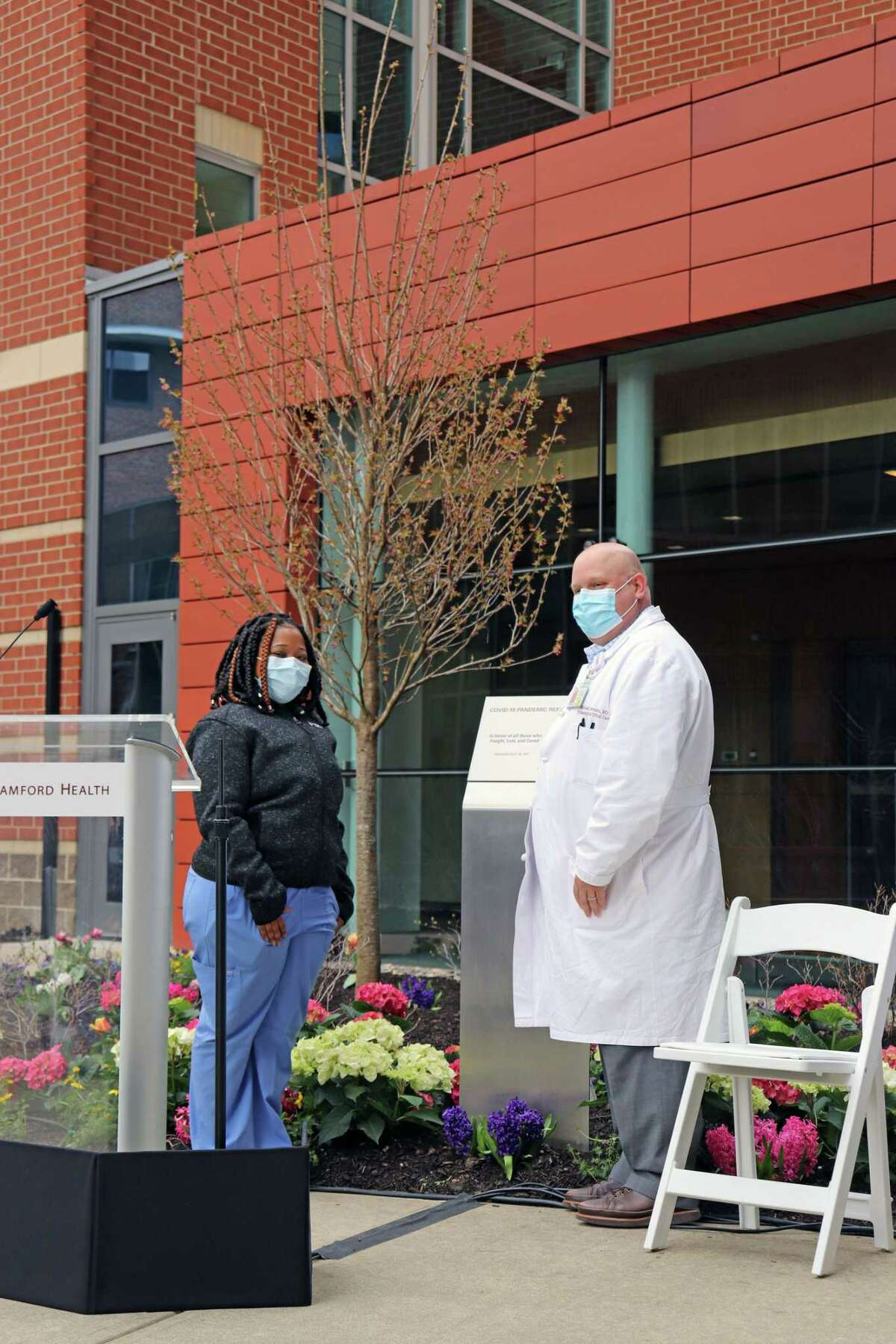 Trisha Lors and Dr. Michael Bernstein dedicate the COVID-19 memorial garden at Stamford Health on Friday, April 16, 2021.