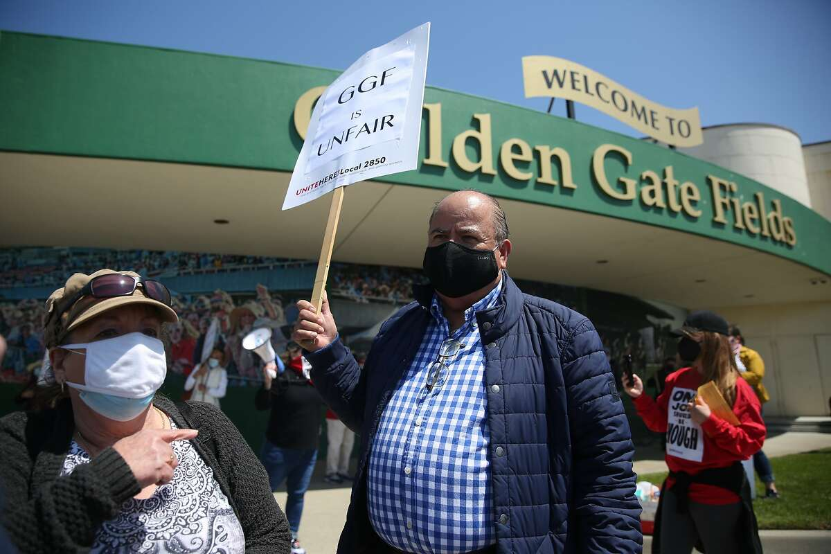 Laid-off Golden Gate Fields concession stand manager Cindy Souza and bartender Alfonso Garcia protest not being recalled to their old jobs.