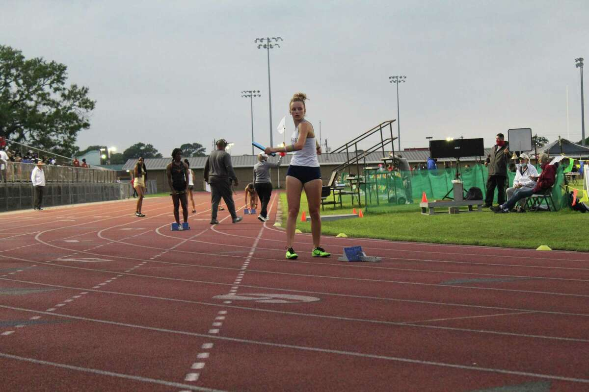 Kingwood's Peyton Varnadoe prepares to run the 4x200 relay at the 21-6A/22-6A area meet at North Shore.