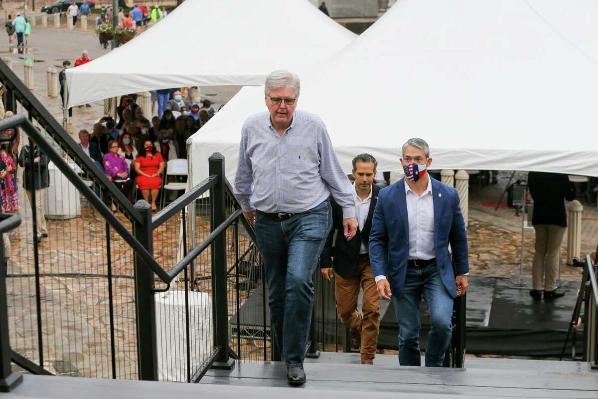 Texas Lt. Governor Dan Patrick, from front, San Antonio Mayor Ron Nirenberg, and General Land Commissioner George P. Bush ascend the stairs to unveil the 18-Pound cannon as state and local officials gathered for the unveiling of a new outdoor