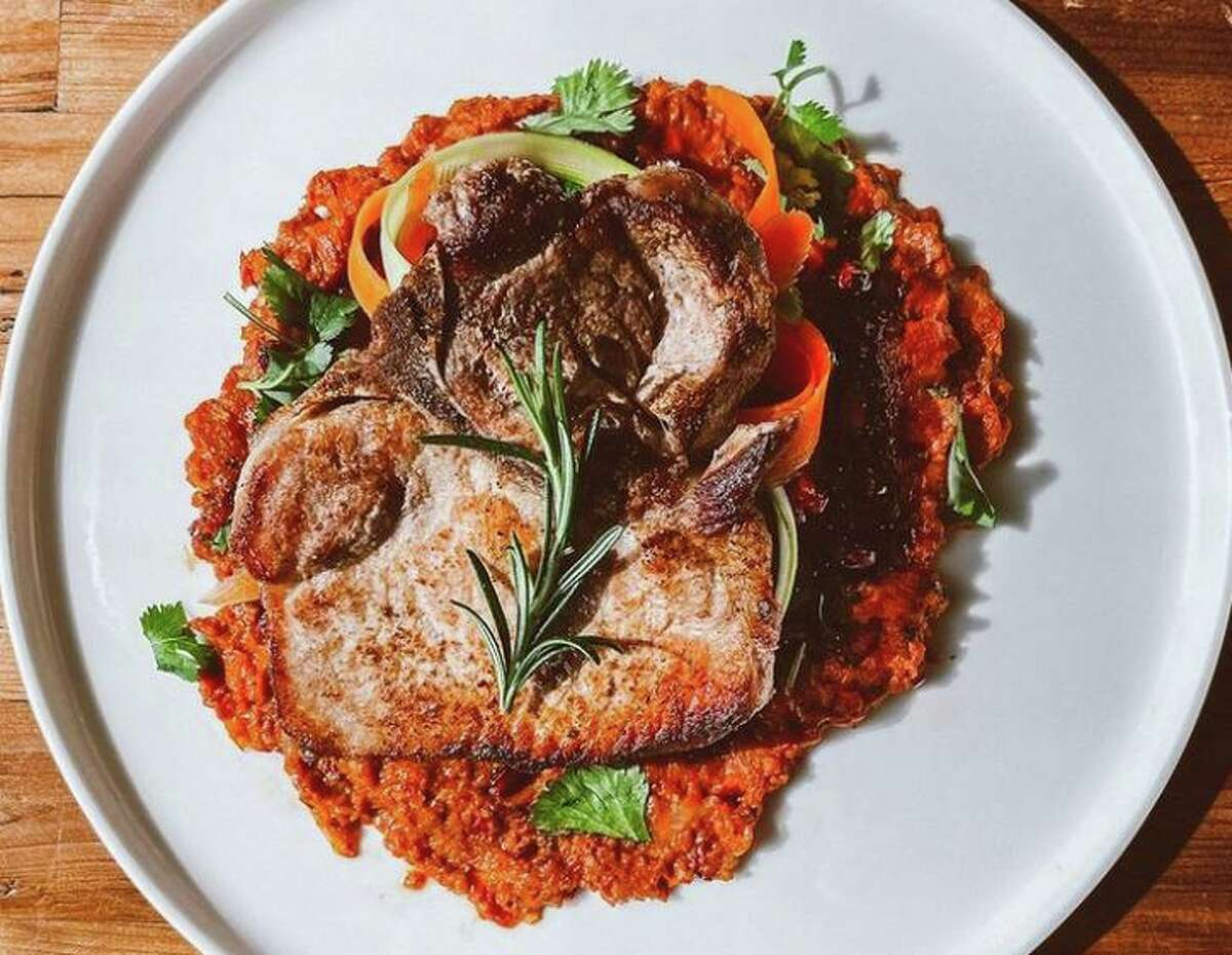 A bone-in pork chop will be a main course featured at the new Stout's Signature near the Tobin Center.