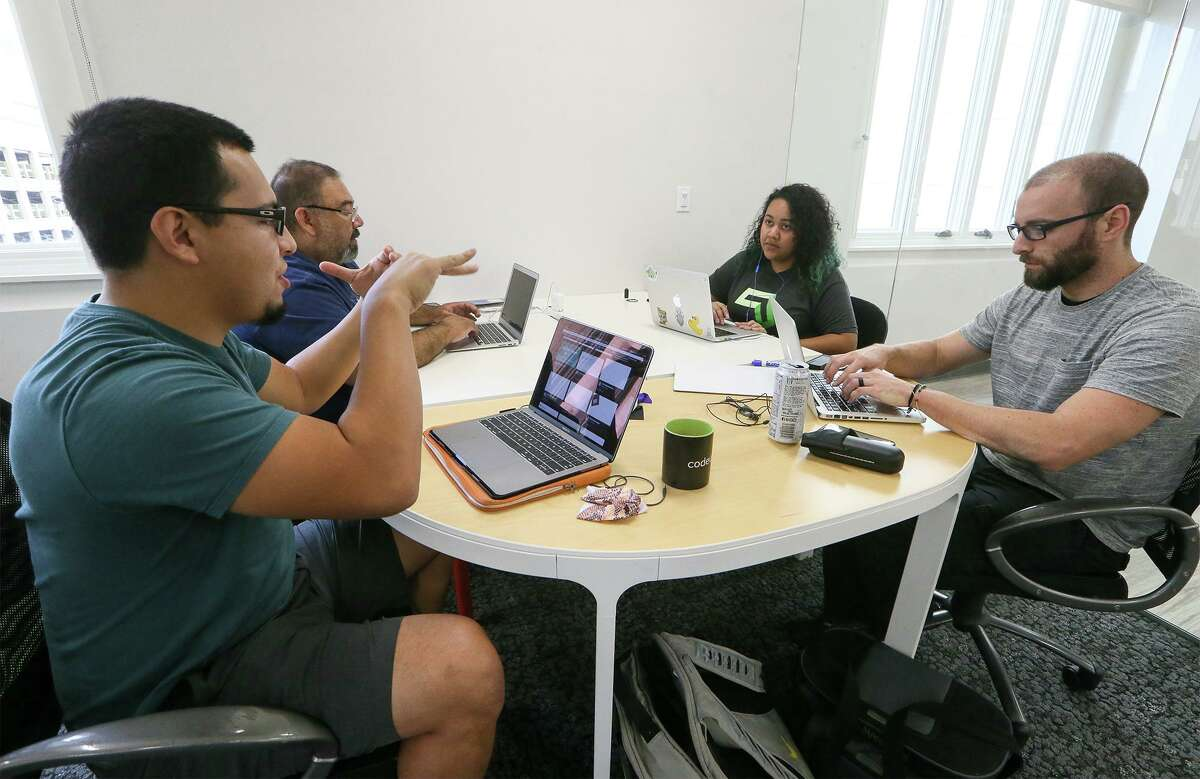 Stephen Apolinar (from left) Mando Sifuentes, Linda Herrera and Justin Rihn work as a team in a Web Development II class at Codeup, a company downtown that offers coding bootcamps for aspiring software developers at 600 Navarro St. #350 on Tuesday, Sept. 25, 2018.