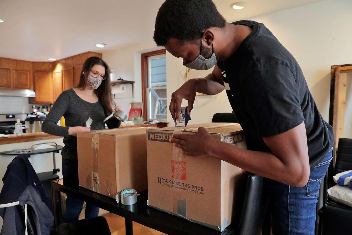 Ernest Brown and Alison Grady pack their belongings in Oakland on March 24, 2021, before their move to Atlanta. The couple decided to leave the Bay Area to buy a home in a place they could afford and start a family.