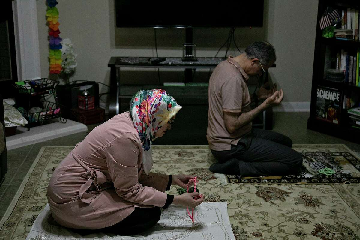 Sumeyra Tek and her husband, Suleyman Tek, pray after the Ramadan dinner at their home in San Antonio on April 15, 2021.