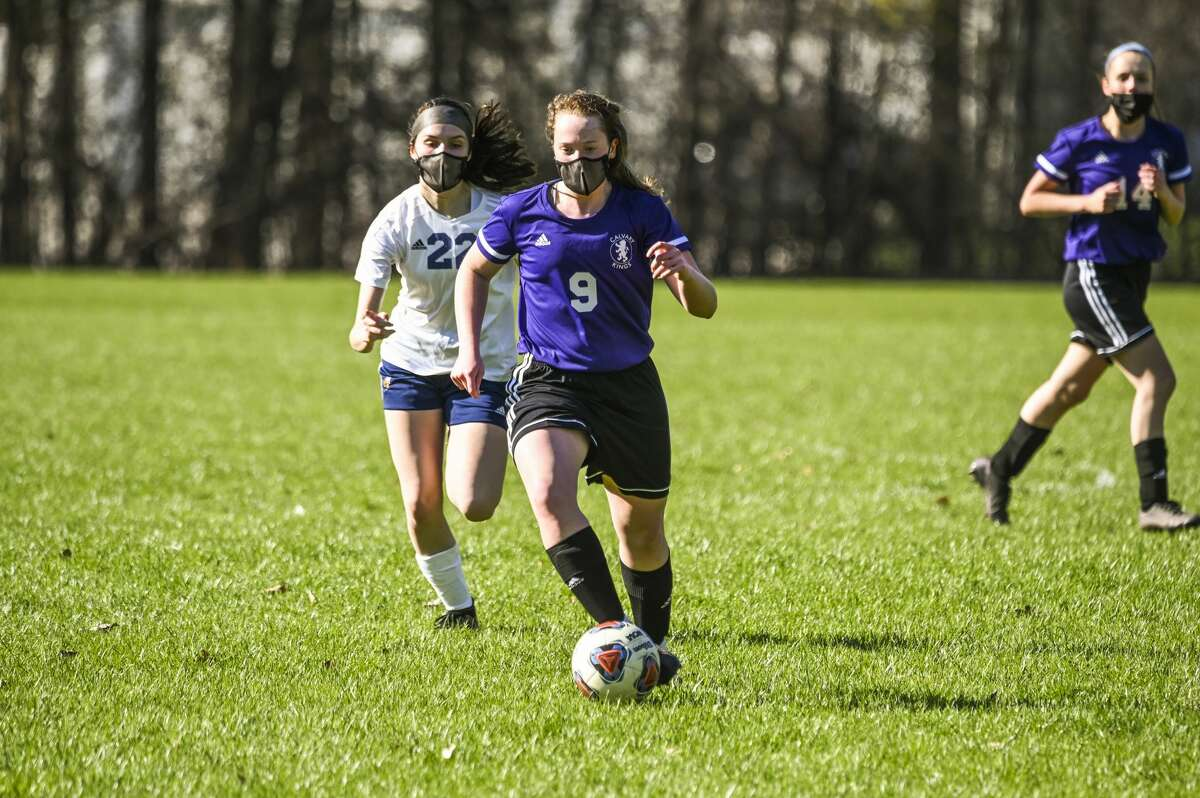 Calvary Baptist's Caitlyn Dickerson dribbles up the field during a game against Ithaca Friday, April 16, 2021 at Calvary Baptist Academy. (Adam Ferman/for the Daily News)