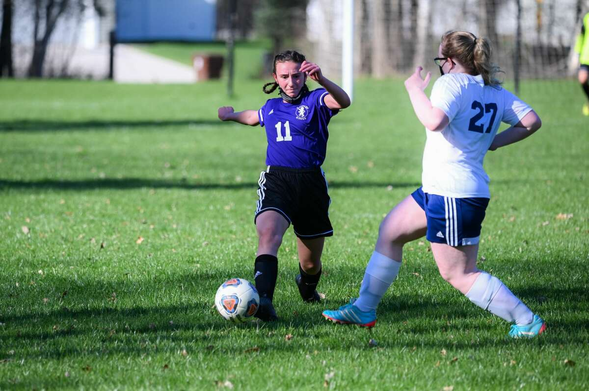 Calvary Baptist's Amanda Wiggins beats her opponent to the ball during a game against Ithaca Friday, April 16, 2021 at Calvary Baptist Academy. (Adam Ferman/for the Daily News)