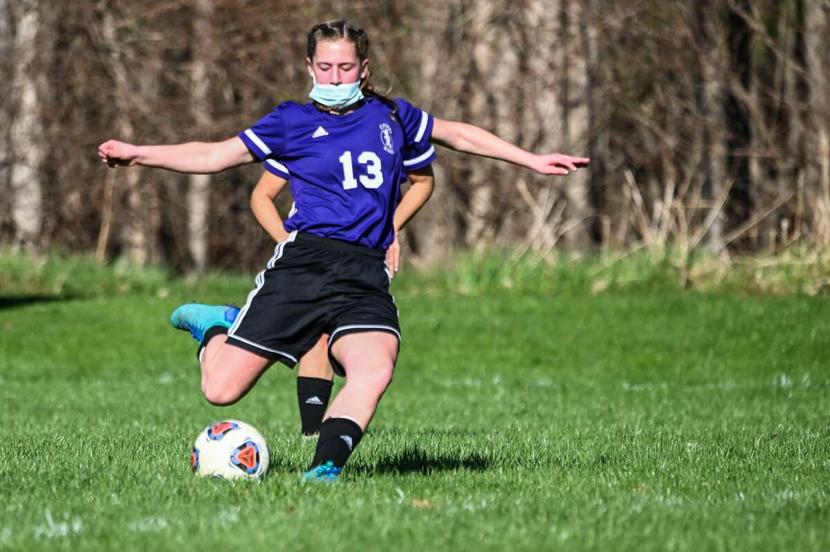 Calvary Baptist's Ila Tomko lines up to kick the ball during a game against Ithaca Friday, April 16, 2021 at Calvary Baptist Academy. (Adam Ferman/for the Daily News)