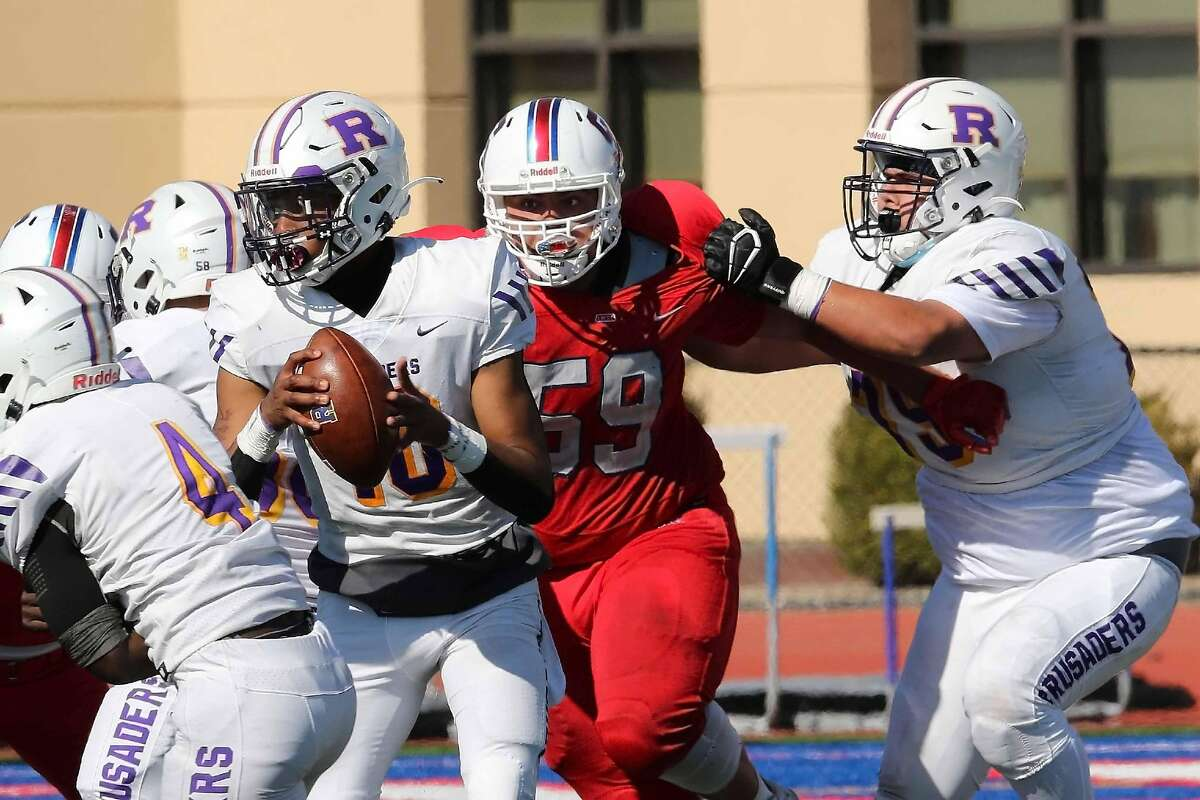 St. Ignatius defensive end Jack Burnett rushes the quarterback.