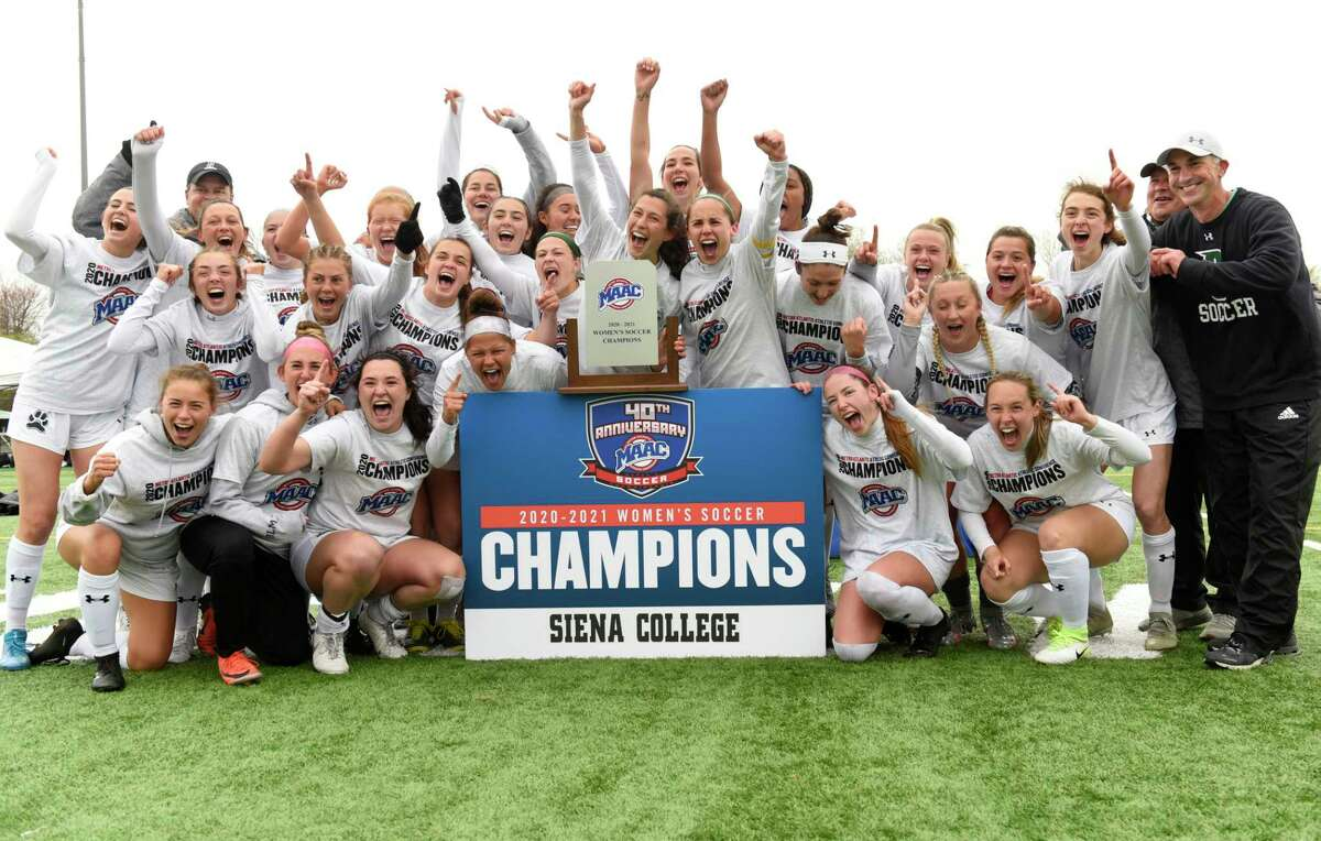 Siena players celebrate after winning a soccer game against Monmouth for the MAAC championship on Thursday, April 15, 2021 in Loudonville, N.Y.(Lori Van Buren/Times Union)