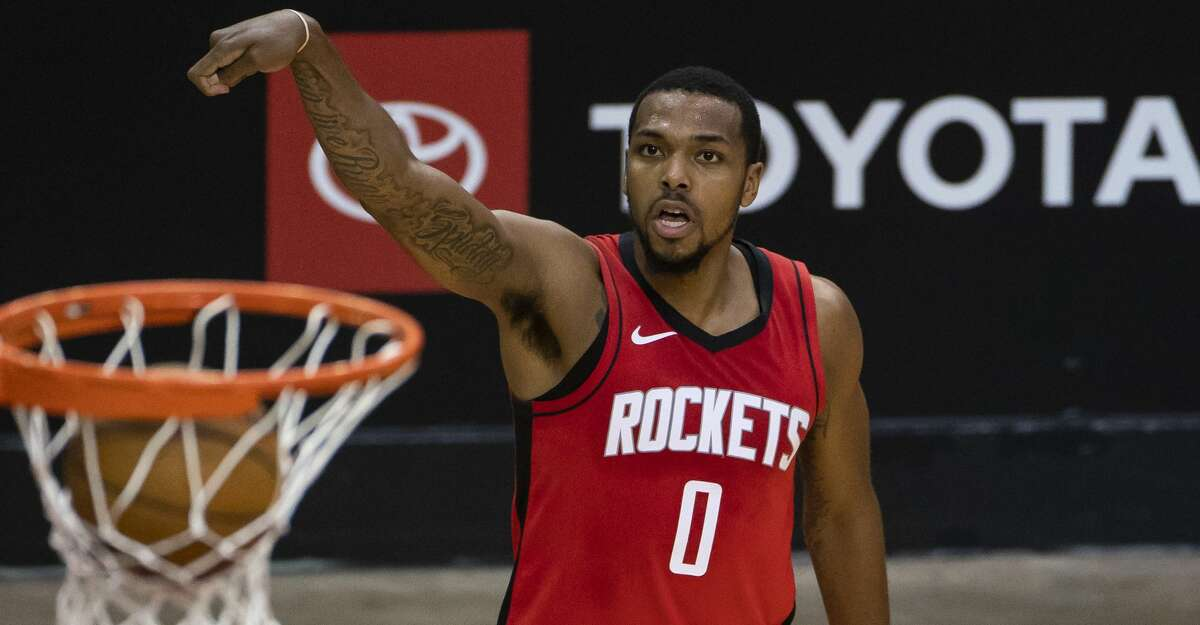 Houston Rockets forward Sterling Brown (0) makes a three point shot during the third quarter of an NBA game between the Houston Rockets and Charlotte Hornets on Wednesday, March 24, 2021, at Toyota Center in Houston.