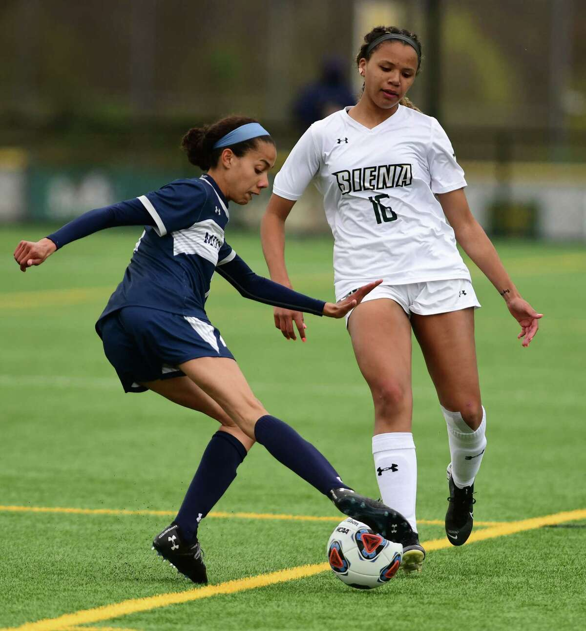 Siena's Annie Bagnall, right, tries to get the ball from Monmouth's Sarina Jones during a soccer game for the MAAC championship on Thursday, April 15, 2021 in Loudonville, N.Y. The Saints meet Arizona State next. (Lori Van Buren/Times Union)