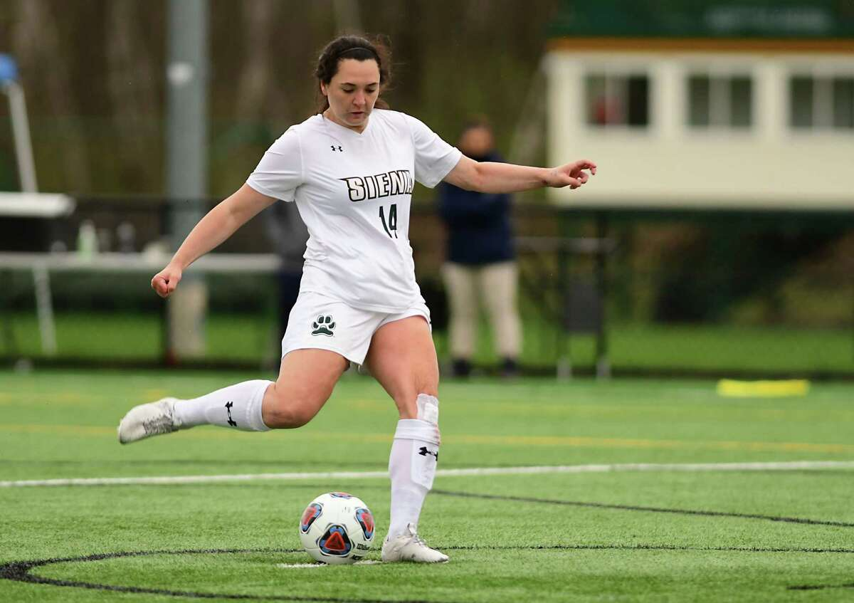Siena's Rachel Sullivan kicks one of the four penalty shots made by Siena to defeat Monmouth in overtime for the MAAC championship on Thursday, April 15, 2021 in Loudonville, N.Y. (Lori Van Buren/Times Union)