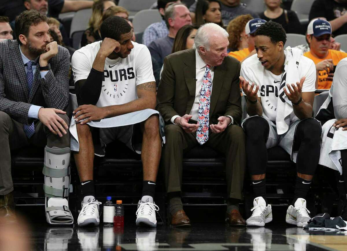 When Gregg Popovich said he heard that former Spurs All-Star LaMarcus Aldridge, second from left, had retired because of a heart condition, he said it reminded him of a scary episode in 2017.